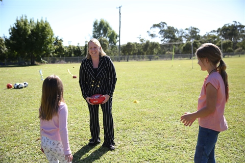 Mayor Byrne pictured with her daughter Alexis and local resident Amber at the School Holiday Fun program.JPG